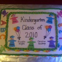 Kindergarten Graduation I did this cake for my daughters kindergarten graduation. Everything is buttercream except for the little people that are made from fondant...