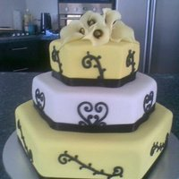 Yellow, Black And White 3 Tier Hexagonal Wedding Cake This is my first attempt at a wedding cake! My friend was very specific about wanting a simple but striking cake in her wedding colours...