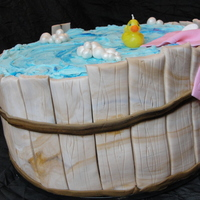 Rubber Ducky Tub This is a tall (10 inch x 2 WASC and 10 inch x2 chocolate) cake, chocolate ganache and buttercream filling. Sides are fondant strips, I did...