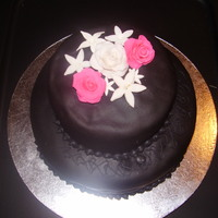 "Pink Roses & White Jasmine On Black This was my Wilton Course 3 ""Graduation"" cake. I made some of my favorite flowers-hot pink roses and white jasmine-out of..."