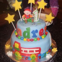 "Fun At One-Boy's 1St Birthday Made this cake for my son Andrew's birthday party to match the ""Fun At One"" theme I chose. The boy is made of fondant/gum..."