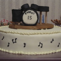 "Drum Set Cake 2 layer - 13 1/2"" oval. Chocolate Fudge cake with semi-sweet chocolate ganache filling and buttercream icing, covered in MMF. The drum..."