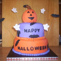 Nephews' Halloween Party 2010 This was for my nephews' Halloween party. 6 and 8 inch round tiers. 6 inch is vanilla cake with cookies and cream filling frosted with...