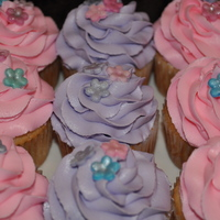 Girlie Cupcakes The client said she wanted pink and purple girlie cupcakes. The are vanilla with french vanilla buttercream and fondant flowers with luster...