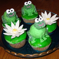 Frog Cupcakes  Frog cupcakes on a pond of blue Jello. The frog bodies are made from donut holes covered in icing, lilypads from fruit roll ups, faces and...