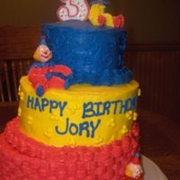 Jory's 3Rd Birthday Cake  Okay Ladies... take it easy on me! This is my first stacked cake, my first time at basketweave and making clowns! I made this for my son&#...