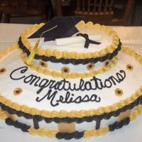 Grad Cake I wish now that I had taken the time to level the cakes. It would've made a big difference I think.