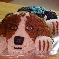 Puppy Cake This is for my brothers birthday. He has a new dog that's 1/2 basset and 1/2 beagle. I didn't have the correct pans to make this...