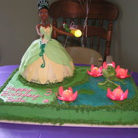 Princess And The Frog  Everything on this cake is edible, except the lights (yes, lights), the doll and her jewelry, and the wire frames for Ray and the two frogs...