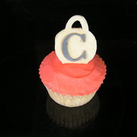 "Cupcake With A 3-D Purse   Purse is gumpaste with a MMF ""C"" that were both cut with my Cricut Cake. The red is buttercream."