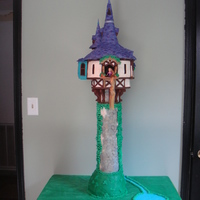 Tangled Tower  I made this cake for my daughter's 4th Birthday. Everything is covered in fondant, but the only parts that are edible are the 10&quot...