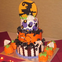 50Th Bithday/halloween Cake 3 Tier Halloween Cake 50th Birthday cake all decorations are made with fondont. Mini pumpkins are done with the Wilton mini pan. Roses are...