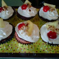 Banana Split Cupcakes Banana Split Cupcakes. Strawberry cake with banana pudding center dipped in chocolate ganache, whipped cream icing with cherry, pineapple...