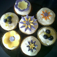 Lemon-Blueberry Lemon filled Blueberry Pound cupcakes with cream cheese icing. Some topped with dusted fondant flowers other with lemon peel and...