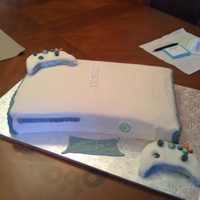 Xbox 360-White Groom's Cake   Xbox 360 White groom's cake covered in Satin Ice fondant. I used the 3D Dense cake mix that is popular here on the CC website.