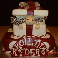 Baby Gift Box Alabama Style Baby shower cake for an avid Alabama fan. Chocolate cake covered in fondant.