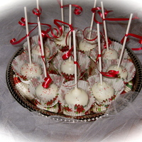 Christmas Cake Pops Pumpkin Spice Cake mixed with Caramel Penuche Icing, and dipped in White Chocolate.