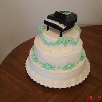 Piano Teachers Cake Flowers and piano are fondant