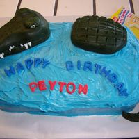 Peys Alligator chocolate cake with rolled fondant alligator. Pound cake was sculpted to the shape of the body then covered in fondant and imprinted with&...