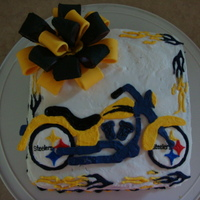 Bike/steelers Birthday Cake I'm in the middle of taking the Wilton classes at Michael's, and this was the first cake I did that was my own design. It was for...
