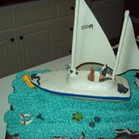 Sailboat With Cupcakes This was my Dad's 60th b-day cake. It was held on a Large Schooner in Mobile Bay, Al. I used mini cupecakes for the water so it would...