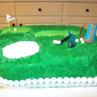 Hole In 1! This was a first for me. The cake is Choclate with Chocolate creame filling. It is iced in vanilla buttercreame and has fondant decorations...