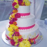 Three Tiered Wedding Cake With Fresh Flowers  Three tiered wedding cake with fresh flowers in pink, yellow and orange - my favorite color combination! It was a perfect day for an...