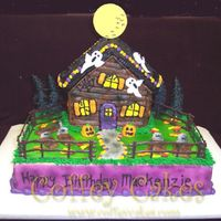 Haunted House  This is a 9x13 and the Wilton stand up house pan. Everything is buttercream except for the fence of course and the moon which I just cut...