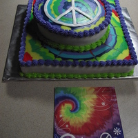 Tie Dye Birthday Cake   this was for my grand daughter. She wanted a tie dye cake with a peace sign. I had fun making it for her. It's iced in buttercream..