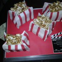 Popcorn Cakes   Vanilla cake, Nutella Filling, bags are made with white fondant and red fondant stripes, popcorn is microwave caramel popcorn