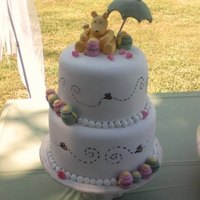 Classic Pooh Shower Cake I made Pooh, Honey Pots & Umbrella out of fondant & gumpaste. The cakes are covered with fondant, the bees are food writer makers....