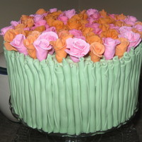"Rose Cake This cake is topped with fondant roses & covered on the sides with fondant ""stems""."