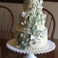 Butterfly Wedding Cake Buttercream covered cake with gumpaste butterflies & leaves.