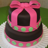 Pink Bow Cake This cake was made for a baby shower, covered with chocolate fondant, with fondant ribbons & dots.