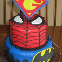 "Super Hero Birthday I made this super hero cake for my son's 5th birthday. His name starts with a ""G"" - hence super ""G"" instead of &..."