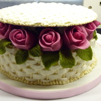 Wicker Basket Of Roses  This was the cake design we made in the second evening class I attended. I used a dummy for this one. The roses are marzipan and this was...