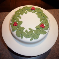 Holly Wreath Christmas Cake   My boyfriends parents asked me to decorate their Christmas cake for them and this was the end result.