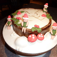 Chocolate Christmas Log Cake With Elves  I saw this design in Cake Craft & Decoration magazine and thought I'd give it a go! I took this cake into work for Christmas 2009...
