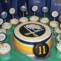 "Buffalo Sabres Hockey Made for my nephew's 11th birthday. 8"" cake iced in buttercream with fondant accents. Hockey puck is a mini cake covered in..."