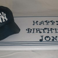 Yankees Hat Cake Key lime cake with raspberry filling for my boyfriend's birthday. Had some issues with the brim...