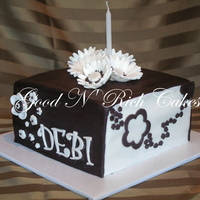 Black And White Birthday This was my first attempt at a square cake... Each side has a different floral design, and is topped with white and black gerbera daisies....