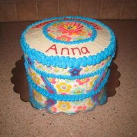 Birthday Cake Cake decorated with Duff's edible tattoos. Royal icing. Store bought guitars and stars. Fondant flower.