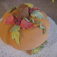 Carved Pumpkin Cake Cake is spiced pumpkin. butercream filling. fondant topping and decorations.
