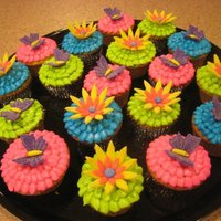 Birthday Cupcakes My daughter loves flowers and butterflies. I made both for her birthday. Made from fondant. Icing tinted with gel tints.