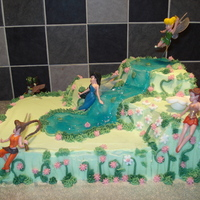 Tinkerbelle   Sponge cake with buttercream icing with fondant accents.