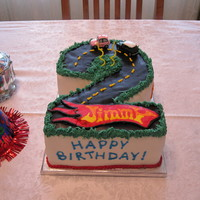 Second Birthday With Cars Carved 2 layer 9x13; covered with MMF and chocolate MMF, buttercream accents and FBCT hotwheels logo. Thanks to all the similar cakes here...