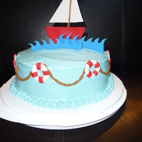 Sail Boat Birthday All decorations were made with Satin ice. Itailian Creme Cake iced with Cream Cheese icing.