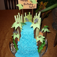 Safari Cake I made everything on this cake except the animals. The waterfall is royal icing. The bamboo and Palm trees are straws wrapped in gumpaste/...