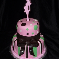 Silhouette Topper Baby Shower Covered In MMF. Cake Decor is Satin Ice fondant (Vanilla and Chocolate). Topper is Gumpaste and Chocolate Fondant. I found a picture of a...