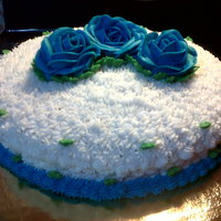 Buttercream Cake FROM: PUERTO RICO RECIPE...my personal recipe.The flower are created in frosting too.